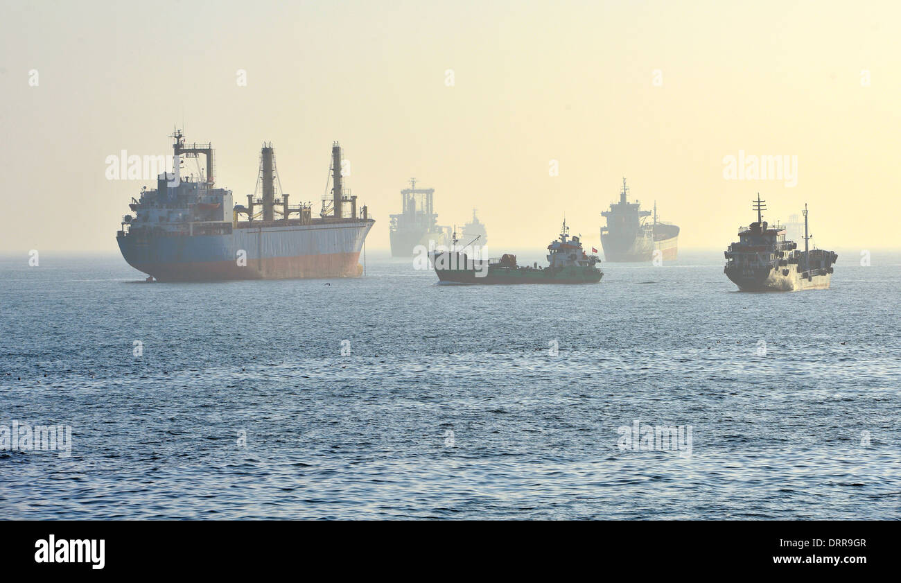 sea cargo ship and oil tanker in the fog - Stock Image