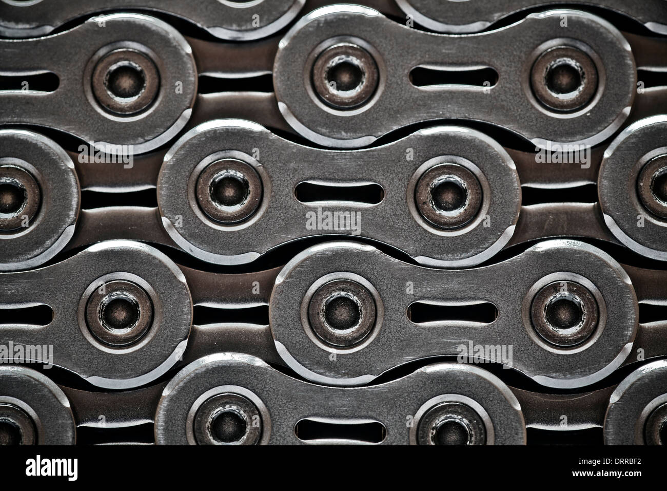 Another link in the chain. Working together. Cogs in the machine. Making wheels go round or a business work. - Stock Image