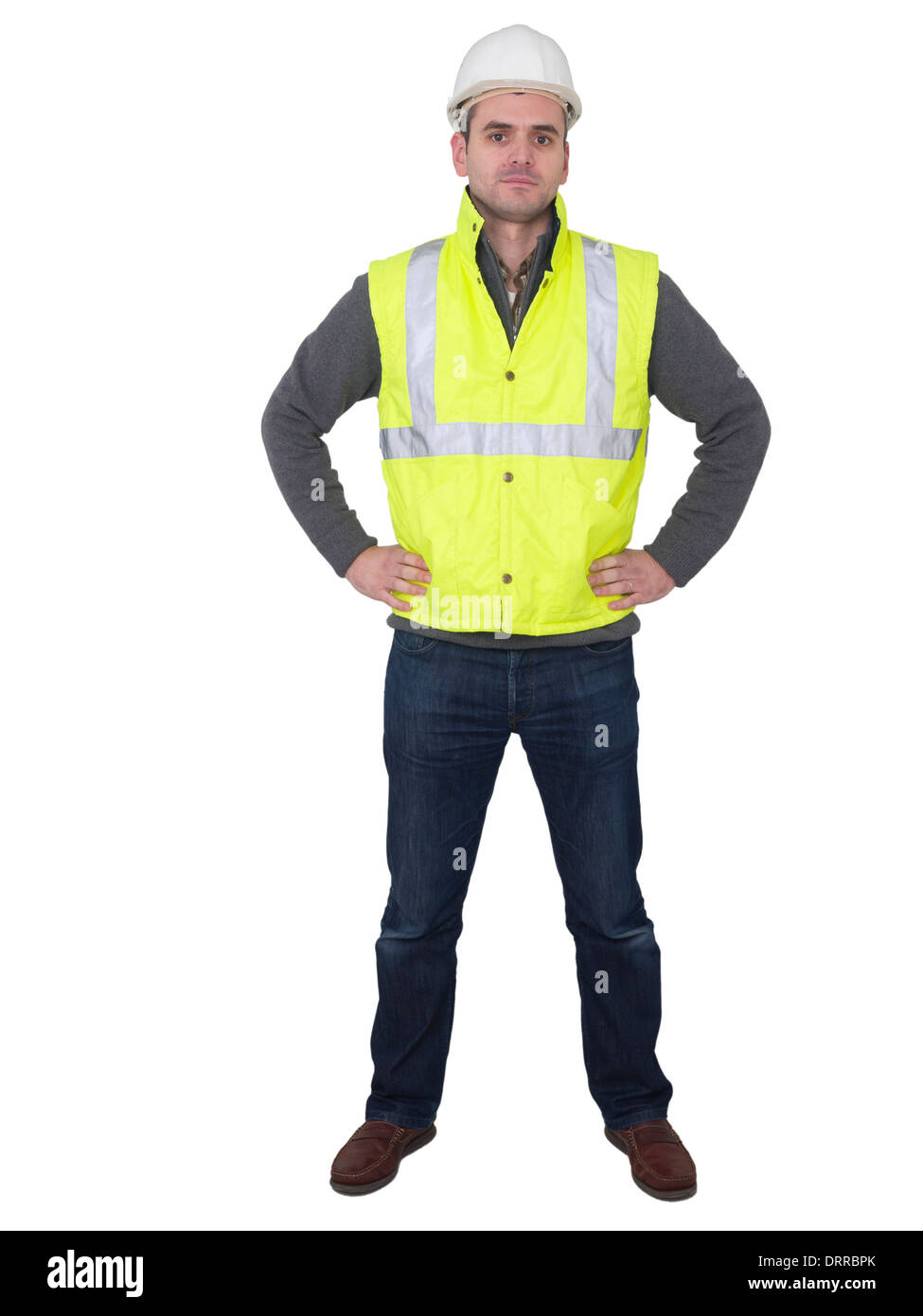 Full-length portrait of engineer with hard hat and yellow reflective safety vest - Stock Image