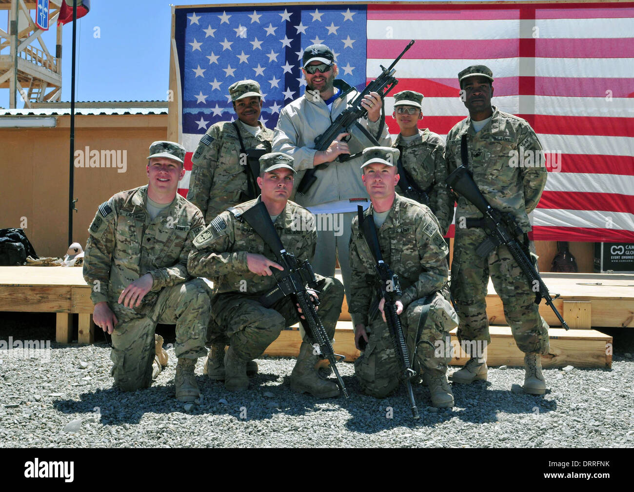 Country music singer songwriter Toby Keith poses with soldiers following a surprise concert April 29, 2012 at Forward Operating Base Sharana in Paktika province, Afghanistan. - Stock Image