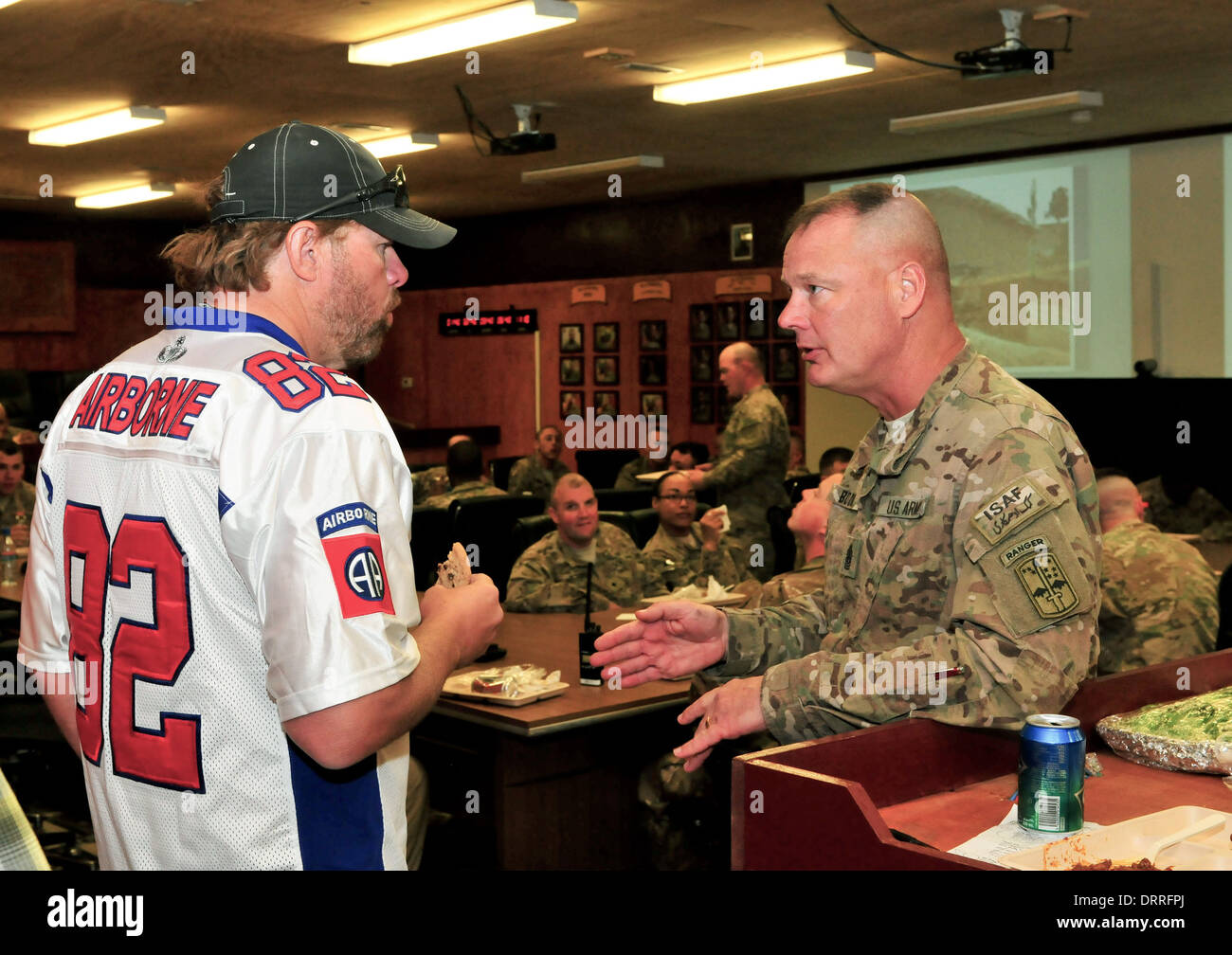 Country music superstar Toby Keith talks with soldiers before performing for the troops April 29, 2012 at Forward Operating Base Sharana in Paktika province, Afghanistan. - Stock Image