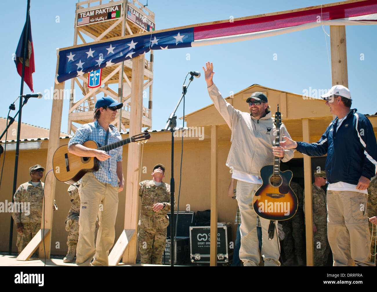 Country music superstar Toby Keith performs for the troops during a surprise concert April 29, 2012 at Forward Operating Base Sharana in Paktika province, Afghanistan. - Stock Image