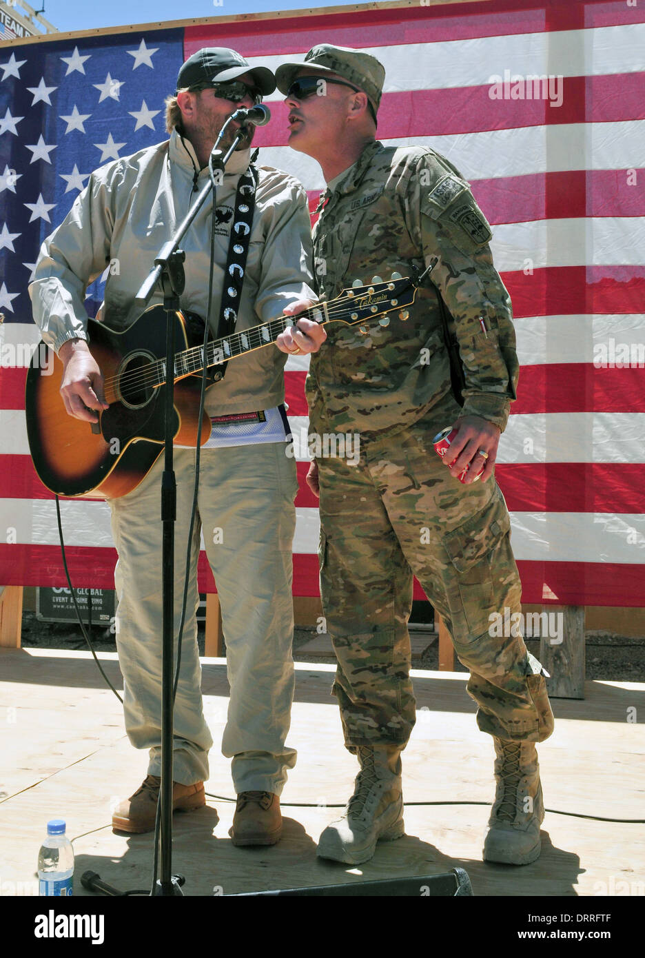 Country music singer songwriter Toby Keith performs for the troops during a surprise concert April 29, 2012 at Forward Operating Base Sharana in Paktika province, Afghanistan. - Stock Image