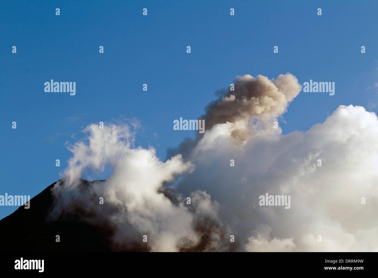 Tungurahua volcano, Ecuador, erupting a small cloud of ash - Stock Image