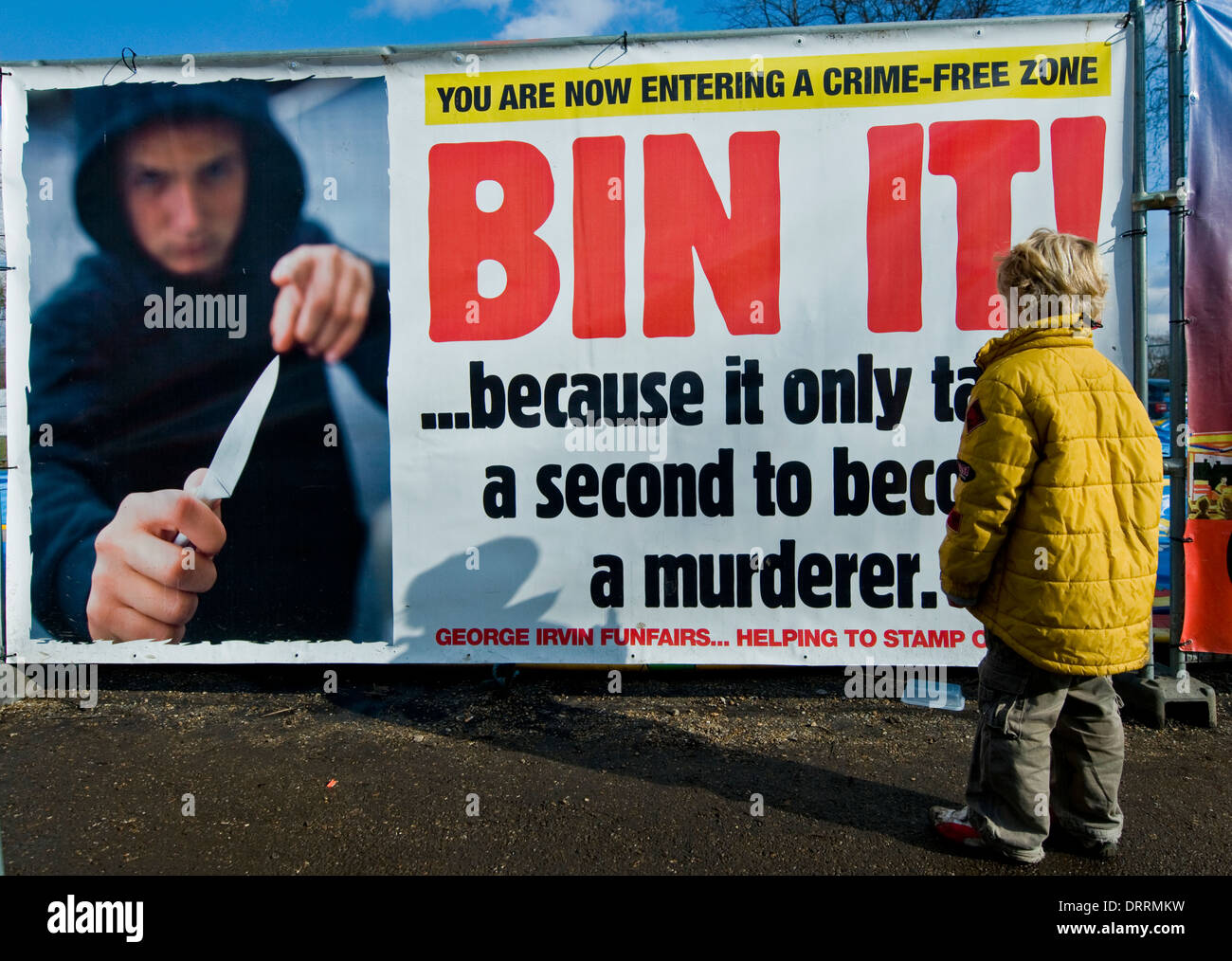 two-boys-look-at-a-knife-crime-billboard