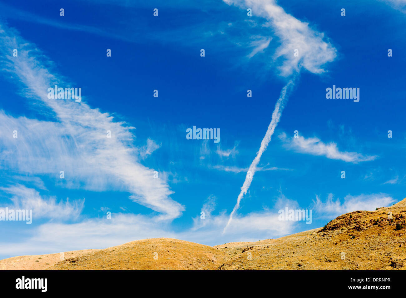 Unusual white clouds against a clear blue Colorado sky - Stock Image