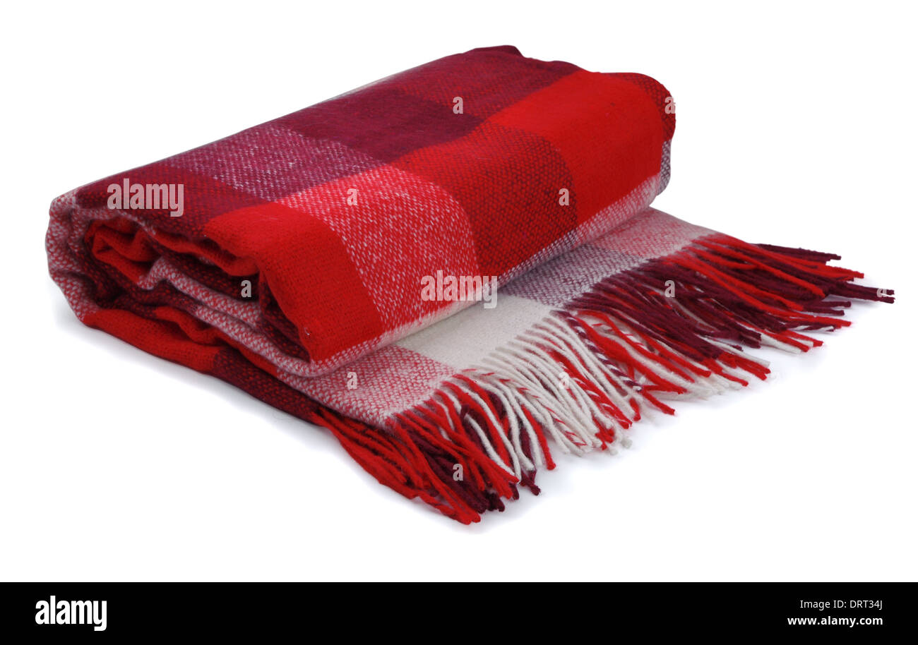 Red checkered blanket on a white background - Stock Image