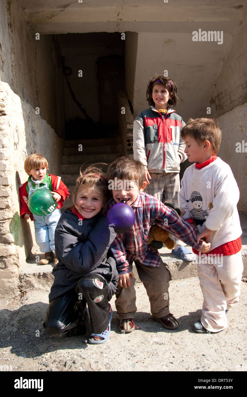 Poor children in front of their house in Fushe Arrez, Albania - Stock Image
