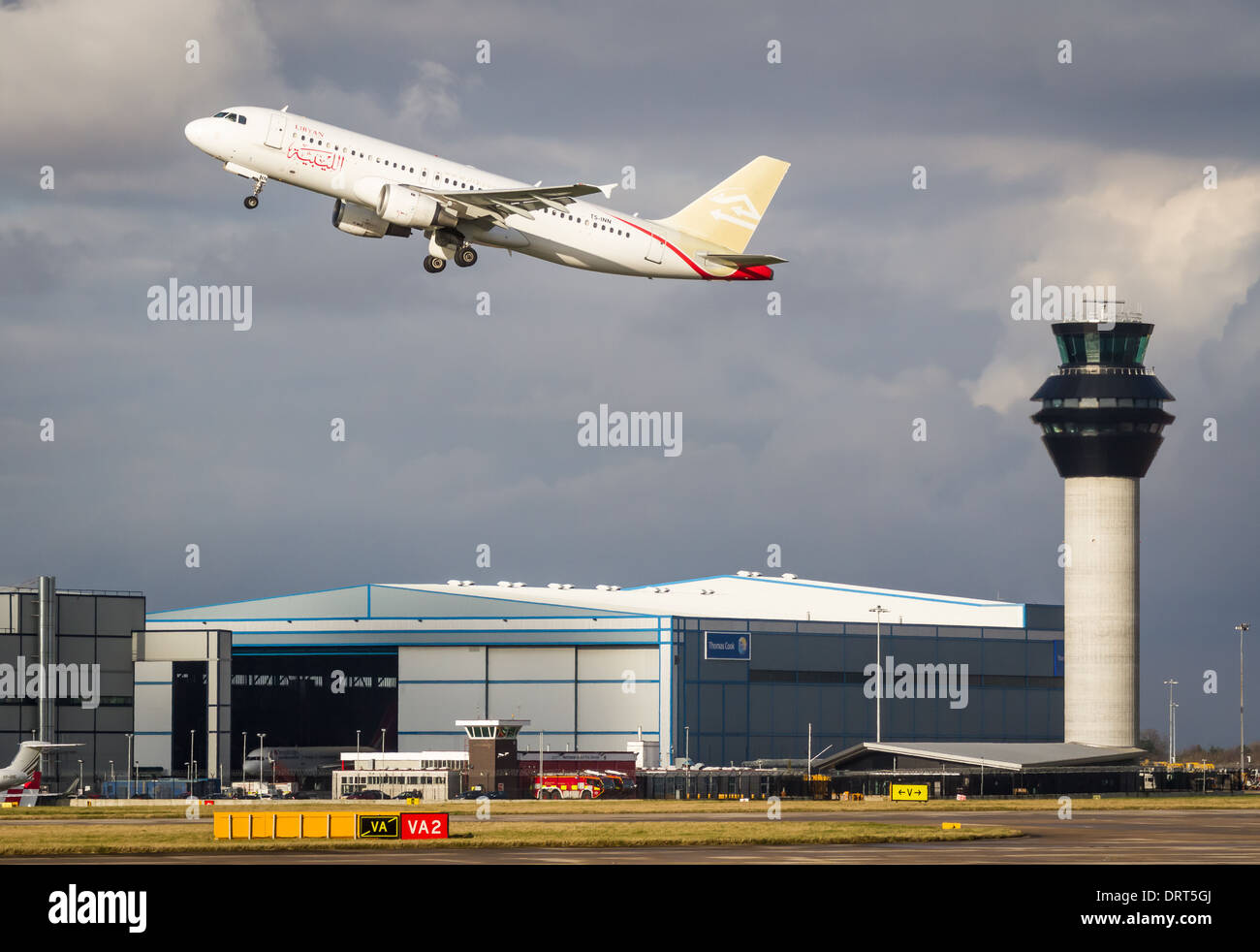 Libyan Airlines Airbus A320-212 TS-INN taking off from Manchester Airport - Stock Image
