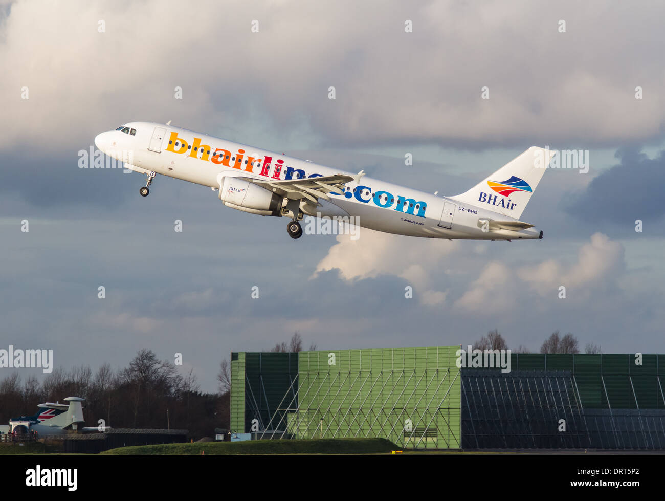 Balkan Holidays Airbus A320 -232 LZ-BHG taking off from Manchester Airport - Stock Image