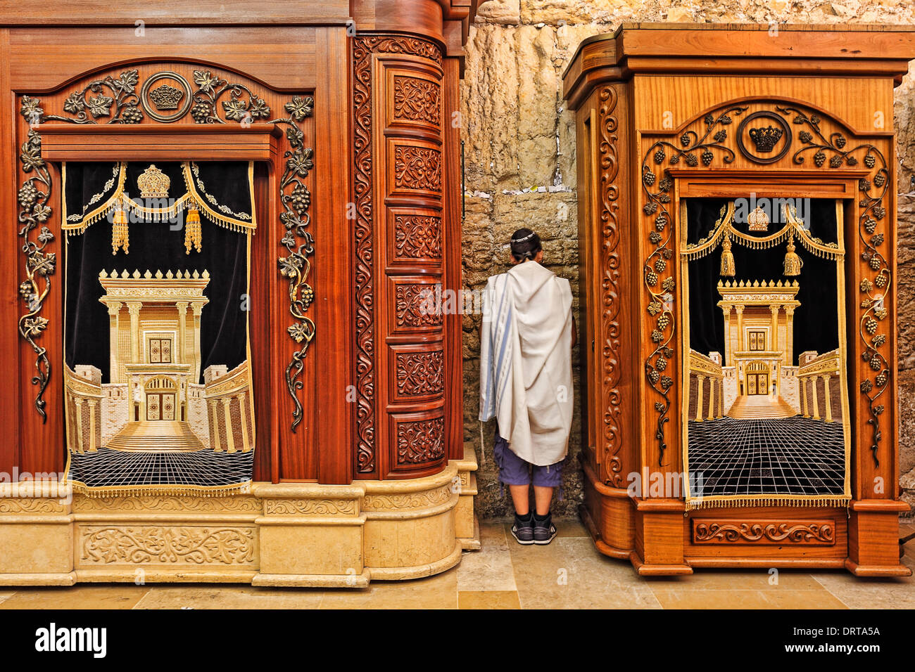 Prayer in Cave Synagogue between two wooden cabinets with Torah scrolls in Jerusalem, Israel. - Stock Image