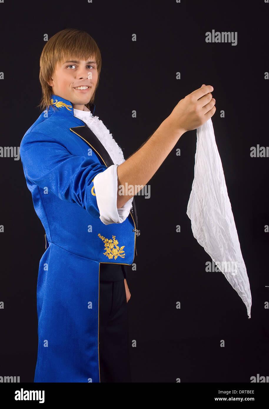 Prestidigitator in tail-coat with neckerchief. - Stock Image