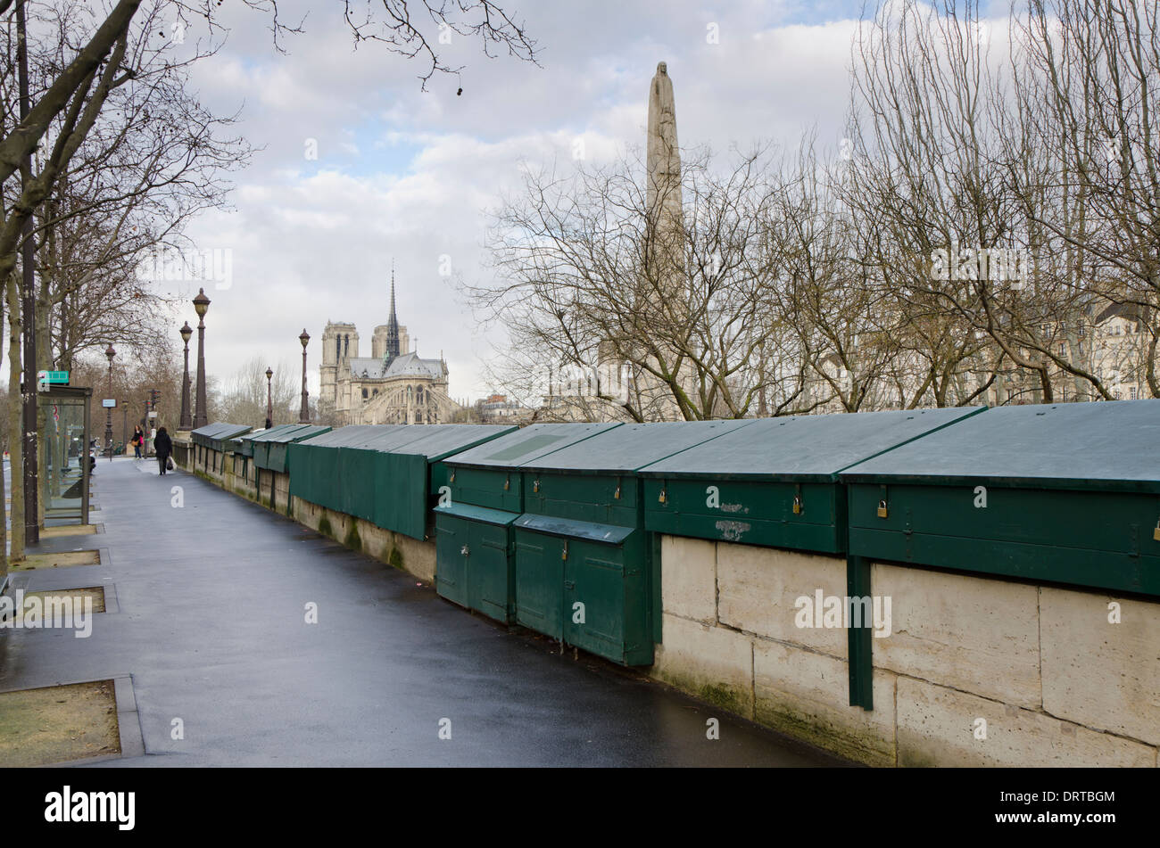 The Bouquinistes, bookseller boxes along the Seine closed due to bad weather. Paris, France. - Stock Image