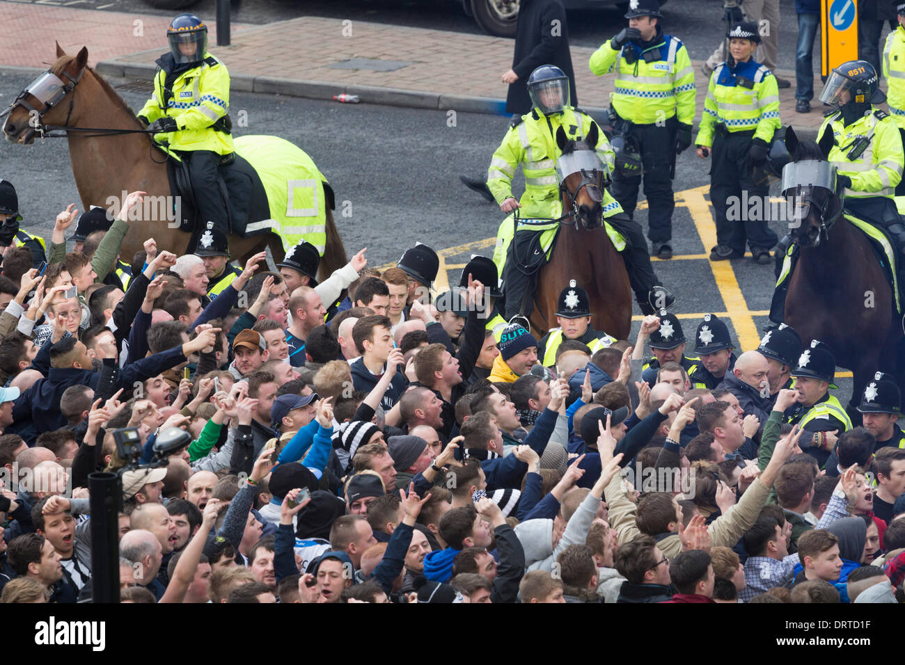 Newcastle United supporters taunting Sunderland supporters who are being escorted to stadium from train station ahead of Newcastle v Sunderland match. UK - Stock Image