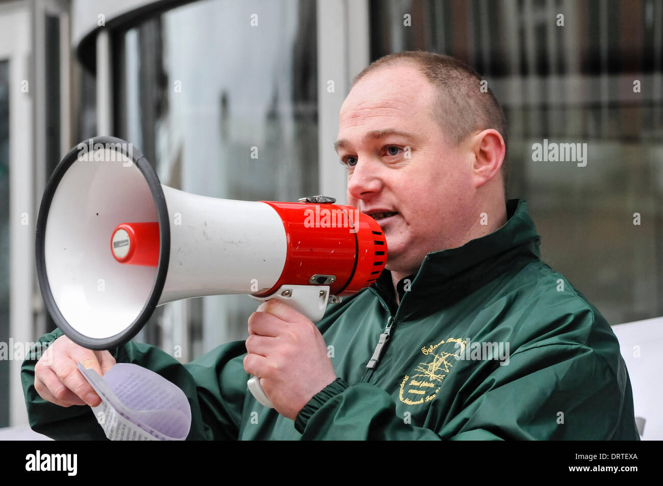 Belfast, Northern Ireland, 1 Feb 2014 - Republican Network for Unity member Sammy Cusick from North Belfast Civil Rights Association gives his speech against lack of social housing and facilities in Belfast. Credit:  Stephen Barnes/Alamy Live News - Stock Image