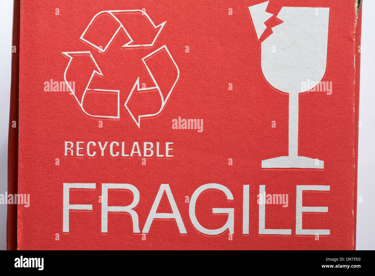 recyclable logo and fragile glass information on cardboard box - Stock Image