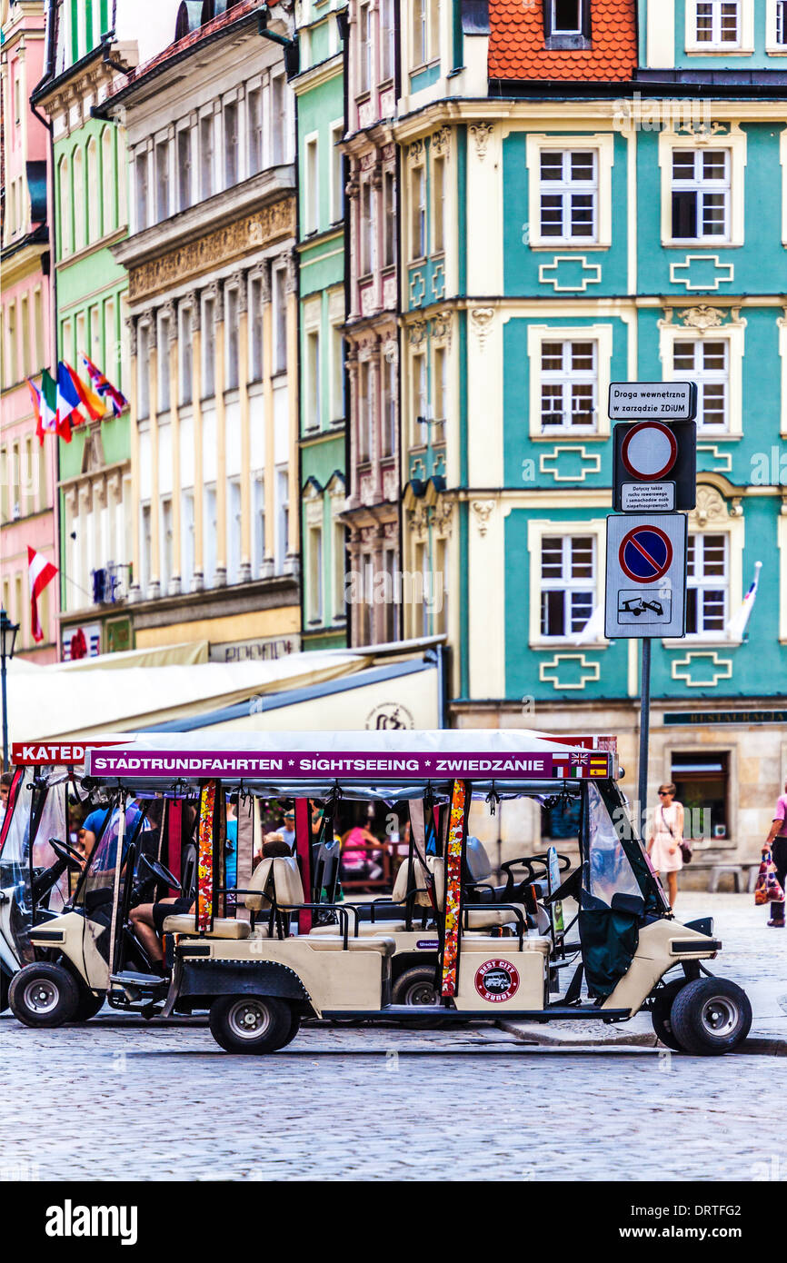 Sightseeing tour buggies parked in the old town Market Square in Wroclaw. - Stock Image