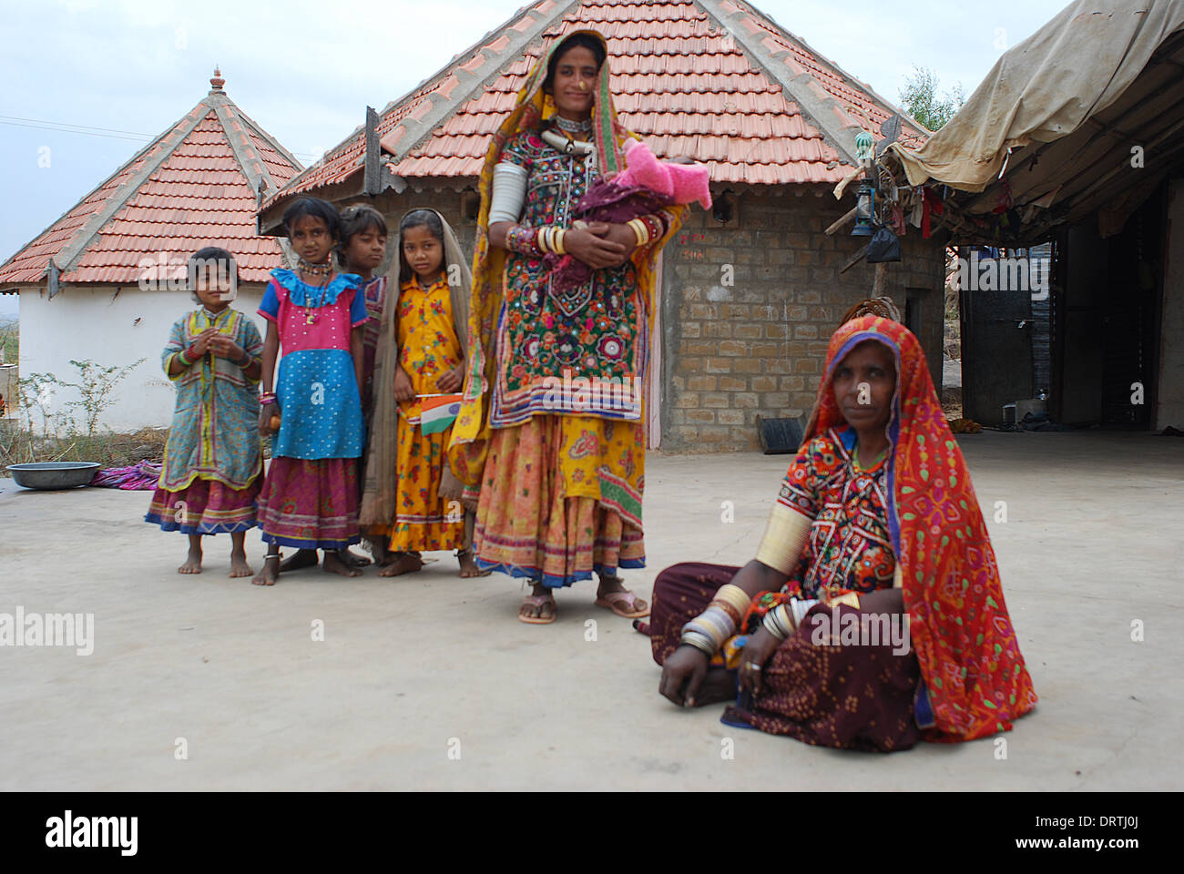 Harijan family in front of their newly built house ( India) - Stock Image