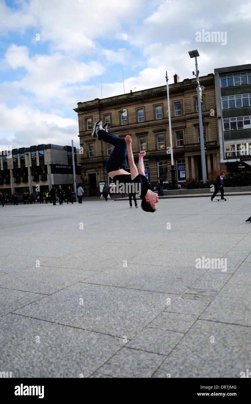 Free Runner Doing Back Flip,Nottinghams Old Market square. - Stock Image