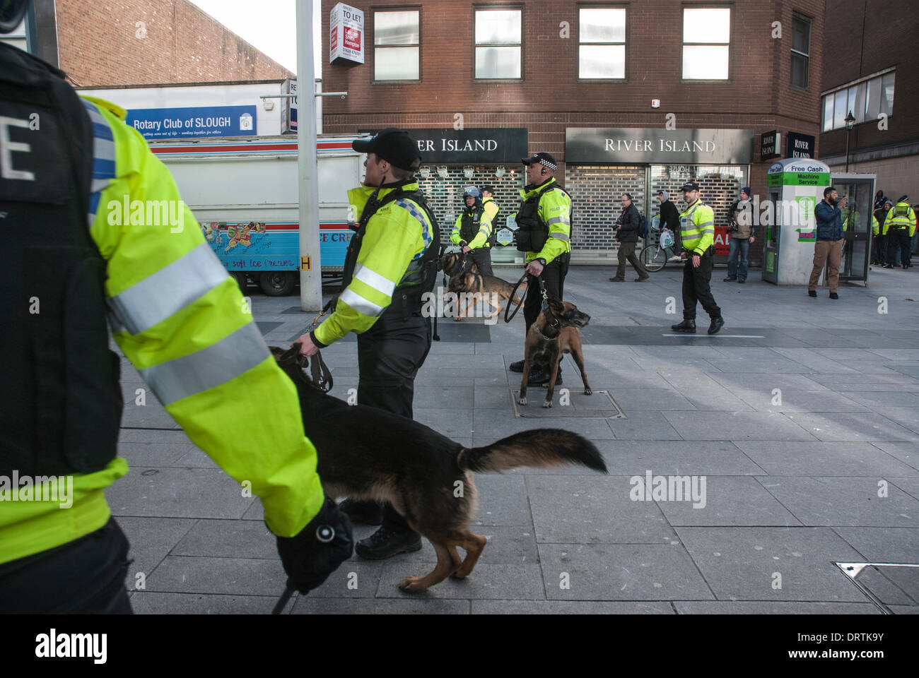 Slough, UK . 01st Feb, 2014. Police dog handlers maintain a separation cordon between EDL supporters and counter-protesters. Slough, United Kingdom. Credit:  Peter Manning/Alamy Live News - Stock Image
