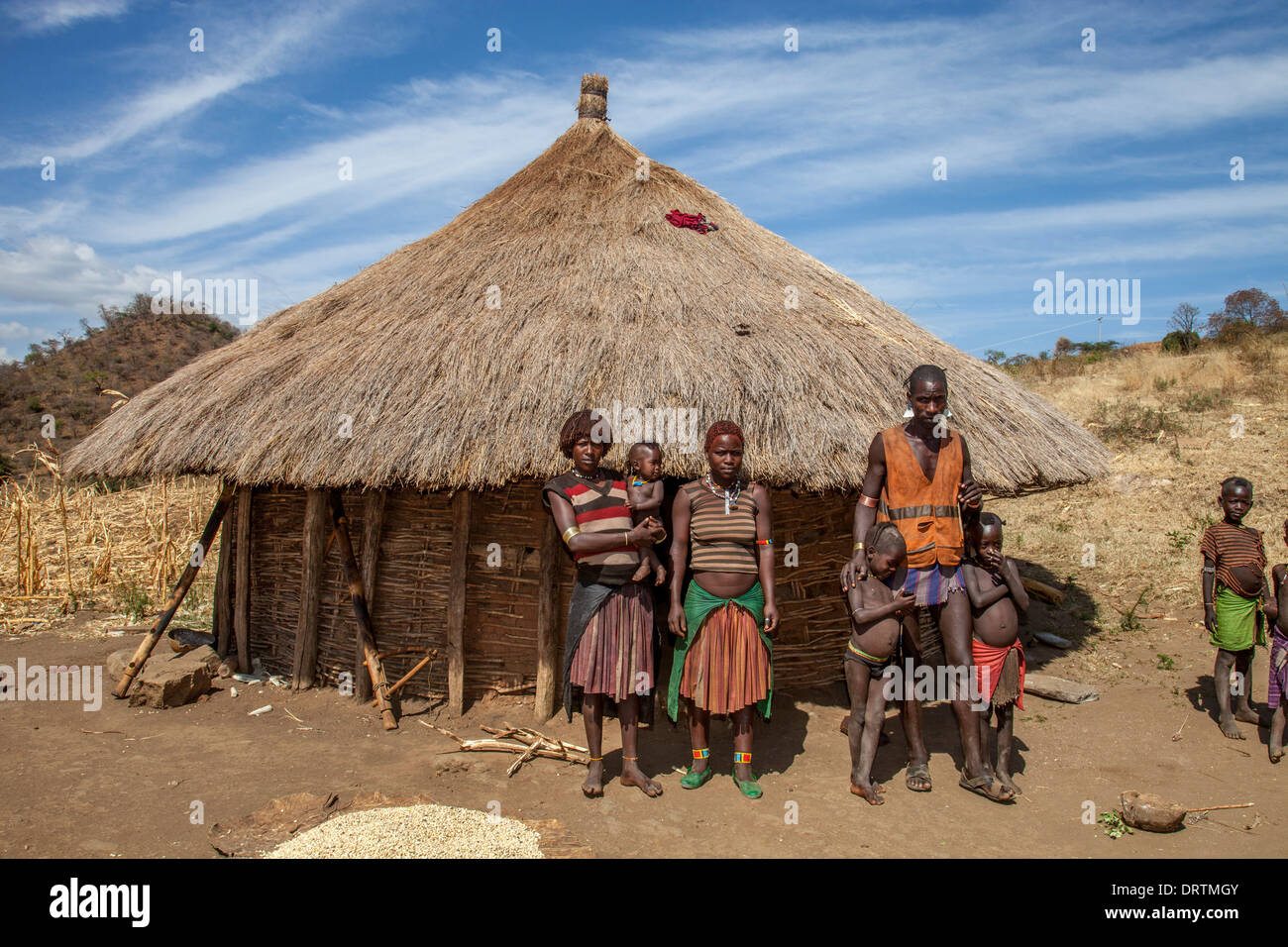 Banna Tribe Family Outside Their Home, Omo Valley, Ethiopia - Stock Image