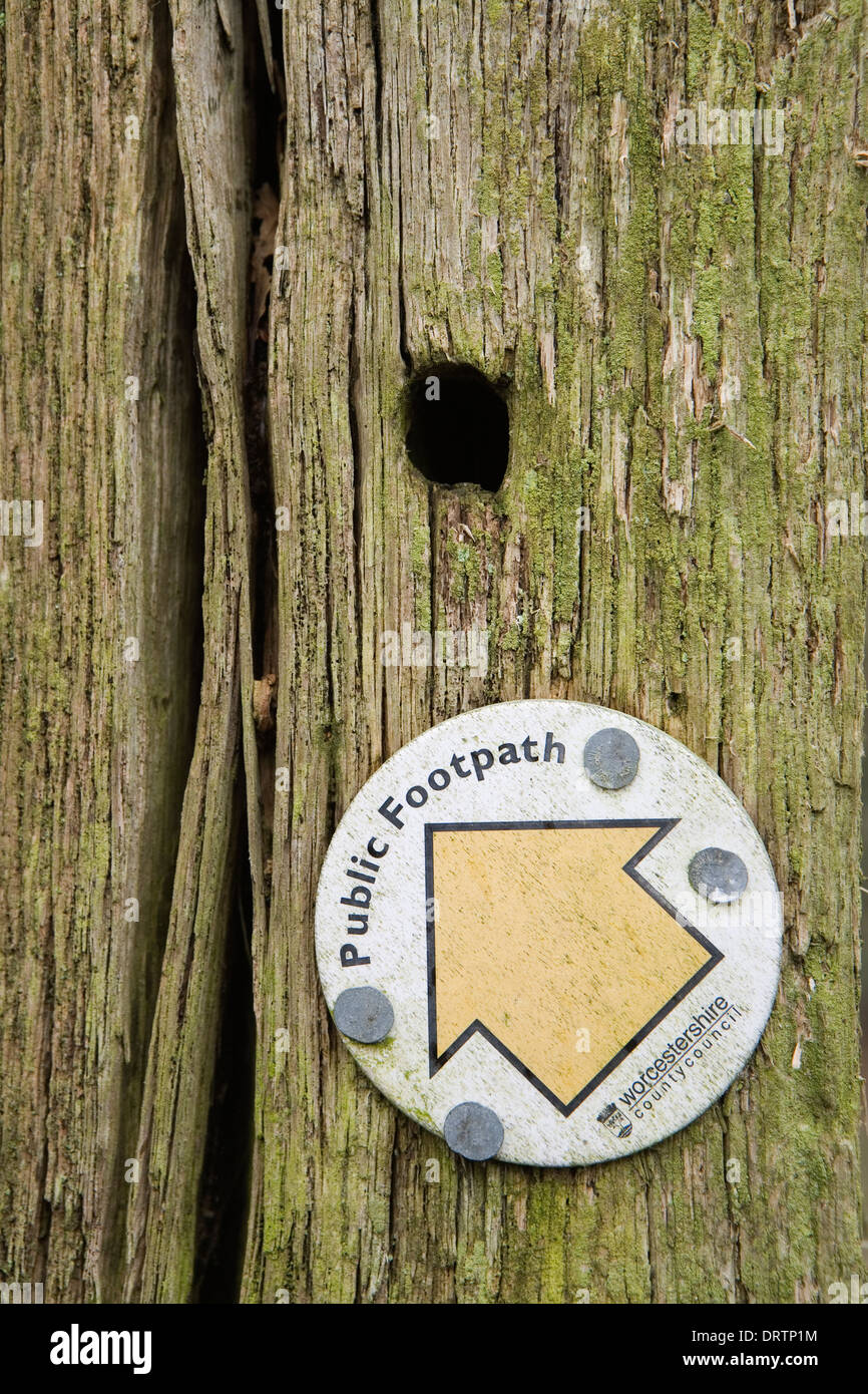 A close up photograph of a Public Footpath sign from the Worcestershire County Council, nailed to an old decaying Stock Photo