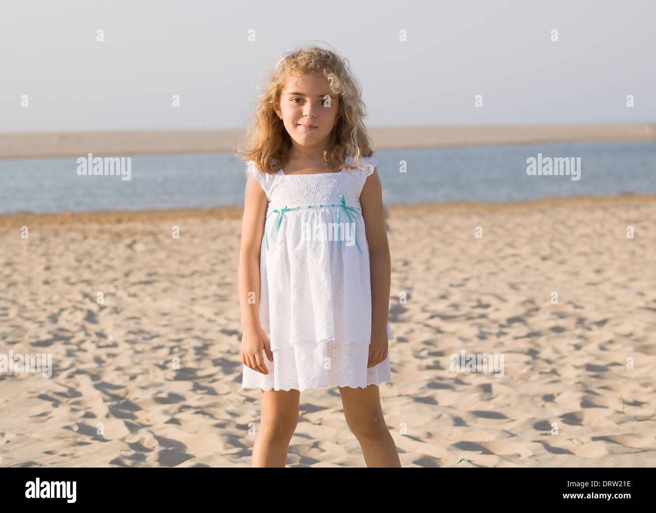 little girl pose beach Alamy