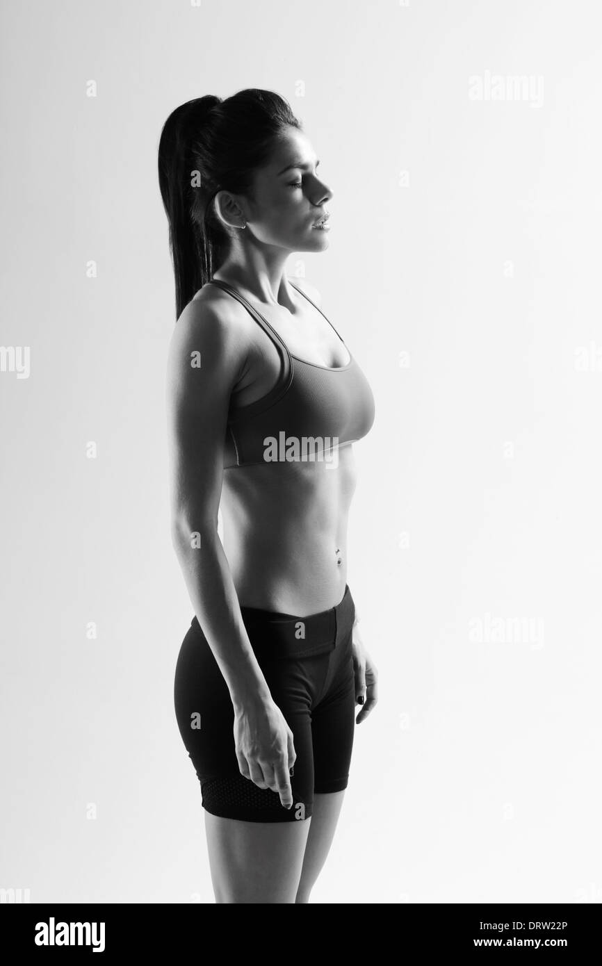 Black and white image of a young tired sport woman - Stock Image