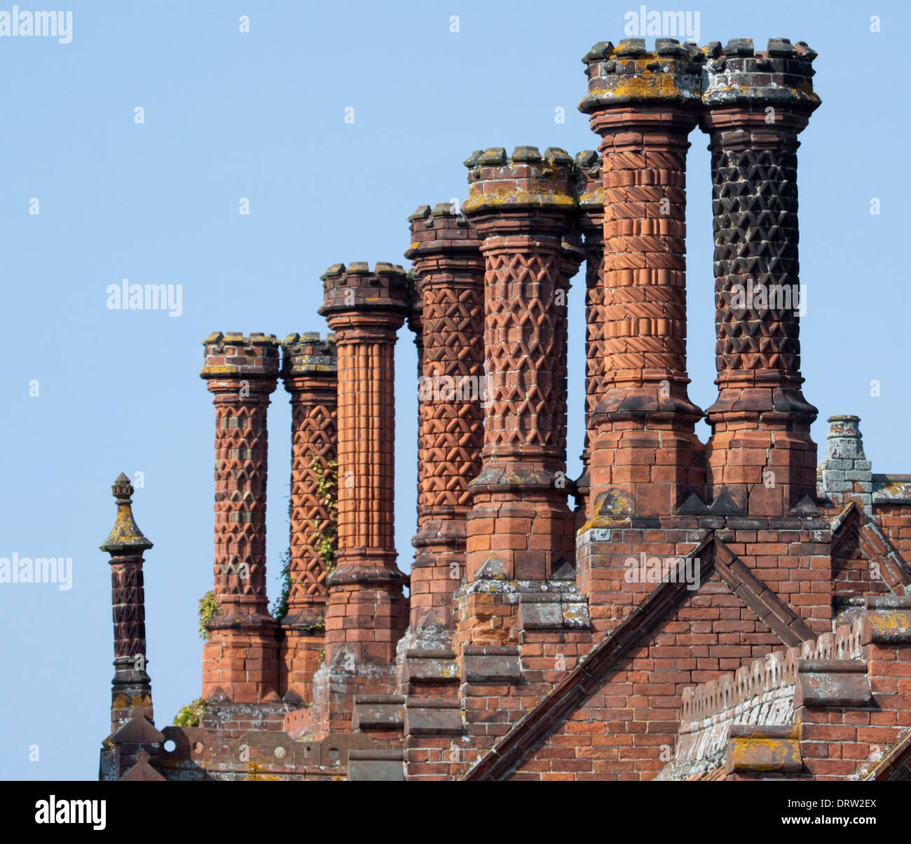 Ornate Tudor style chimney pots - Stock Image