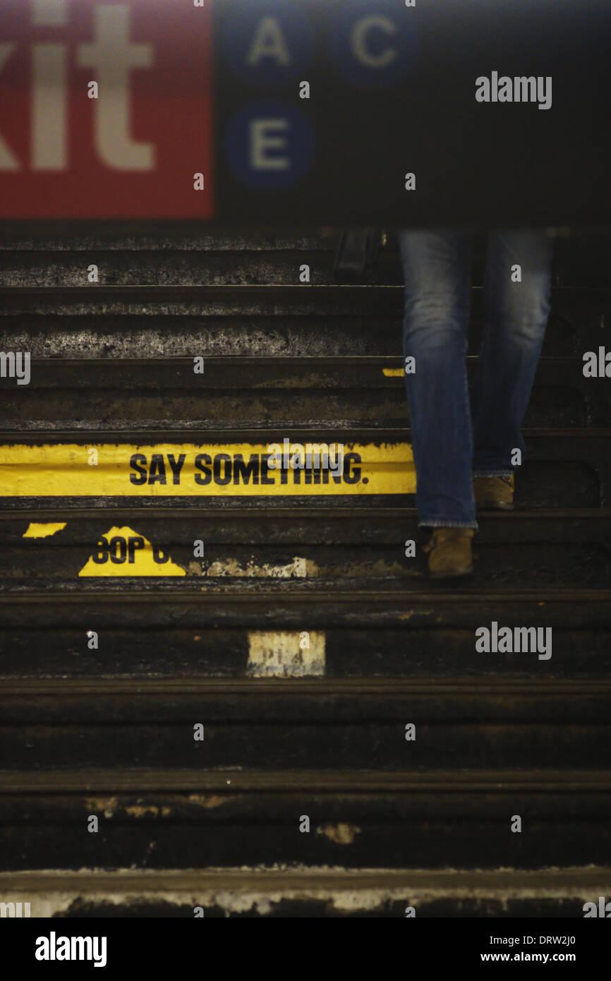 Legs descending New York subway stairs - Stock Image