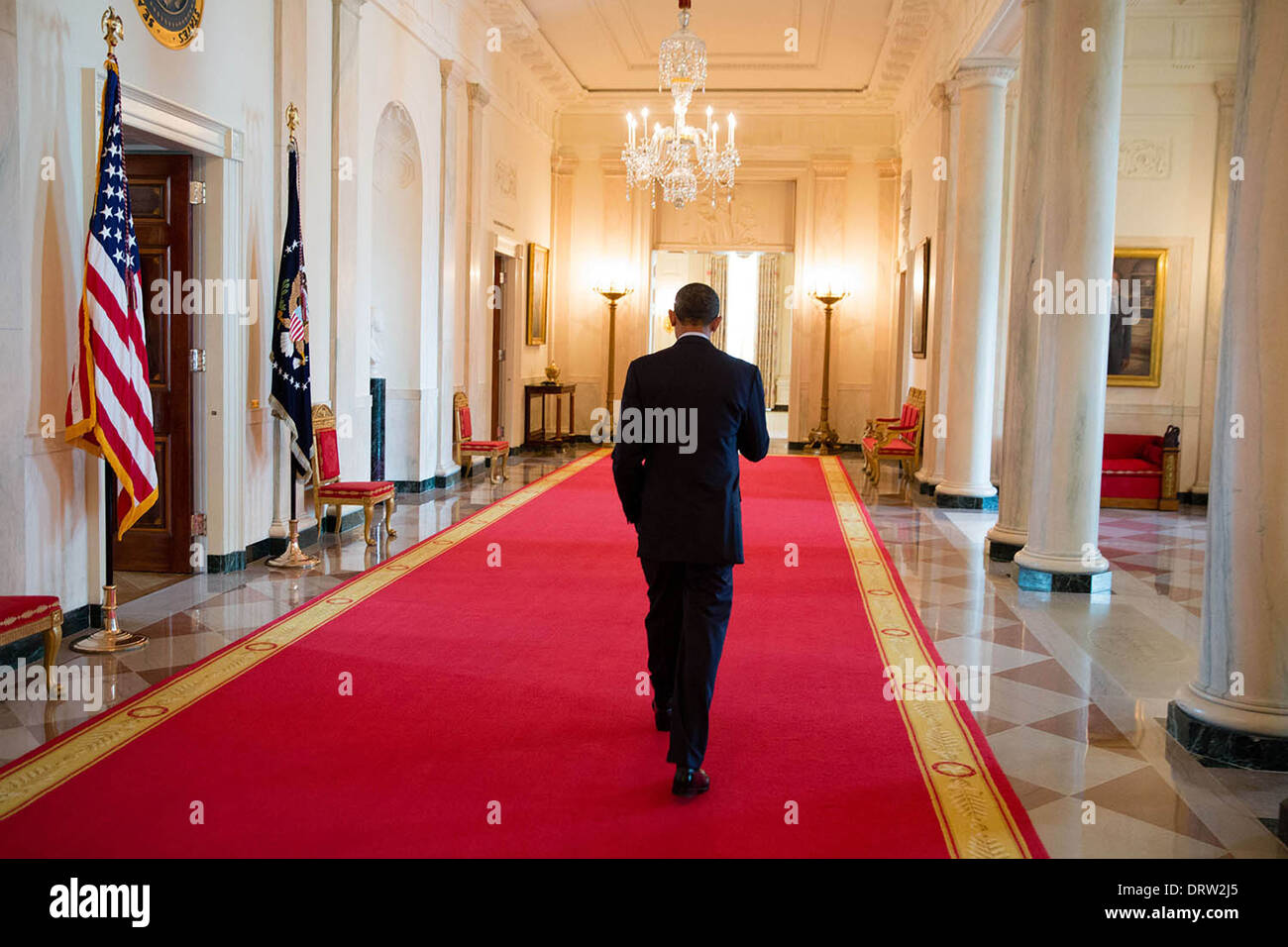 Relatively US President walks alone down the red carpet of the Cross Hall of  GV98