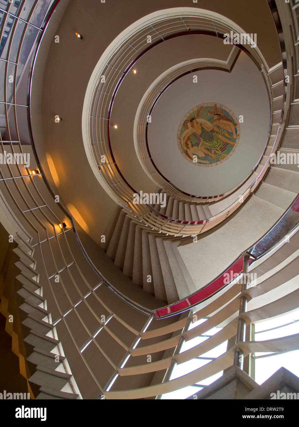 A Grand Spiral Stair In Art Deco Style Leads Up Towards A Ceiling Which  Bears An Original Eric Gill Painted Bas Relief Sculpture