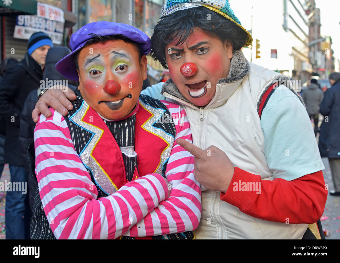 2 Mexican American clowns at the Chinese New Year parade on Mott Street in Chinatown, New York City. - Stock Image
