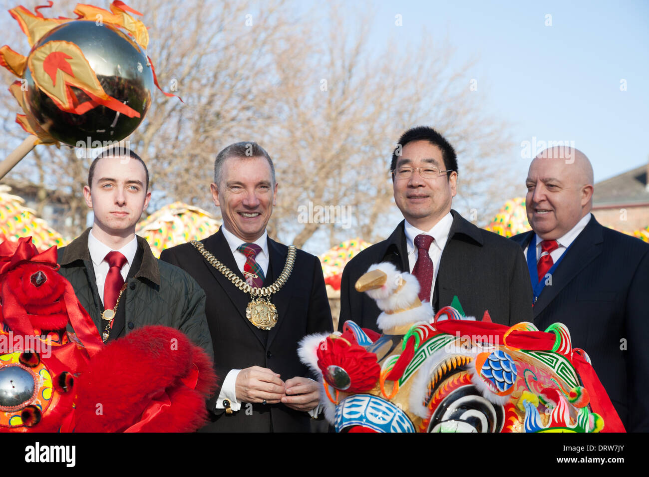 London, UK. 2nd Feb 2014. Lord Mayor of Liverpool Gary Millar and Liverpool Mayor Joe Anderson pose with Chinese Dragons during Chinese new Year celebrations in Liverpool. Liverpool has one of the oldest Chinese communities in Europe. Credit:  Adam Vaughan/Alamy Live News - Stock Image