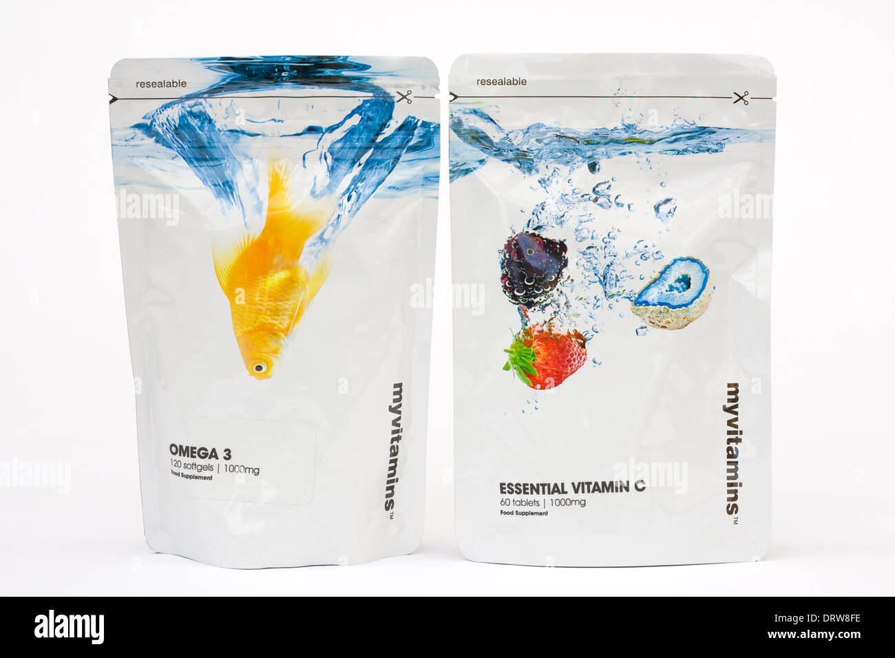 Vitamin C and Omega 3 pouches on a white background. - Stock Image
