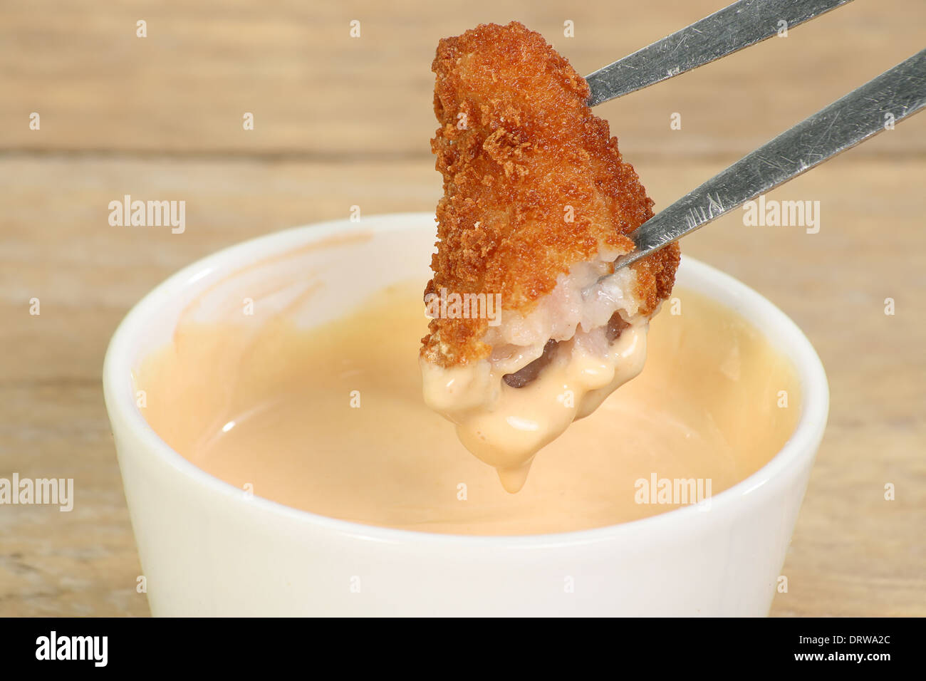 single breaded scampi dipped in seafood sauce Stock Photo