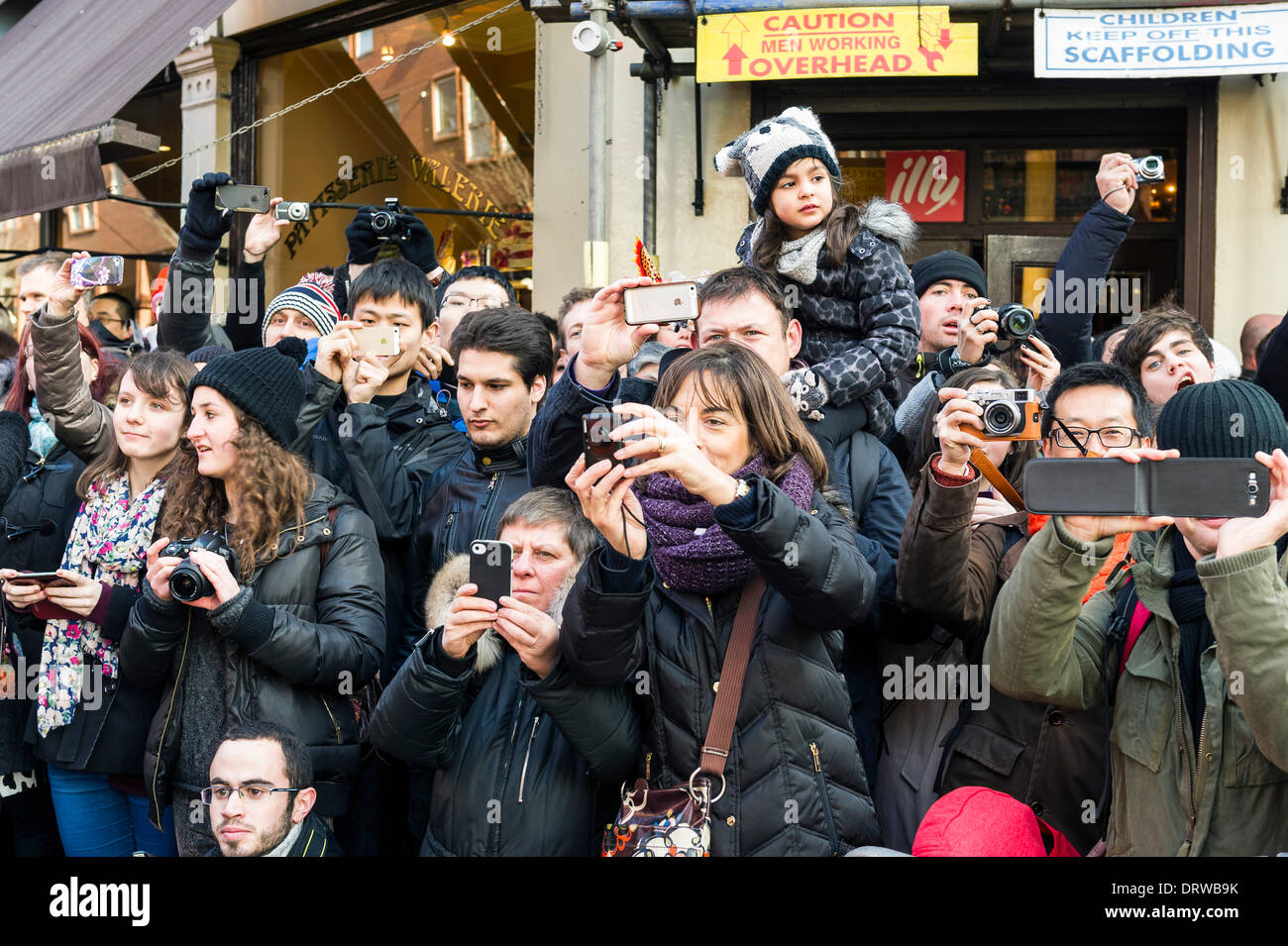 Charing Cross Rd, London, UK. 2nd February 2014. Members of the public photographing the Chinese New Year parade. Credit:  Gordon Scammell/Alamy Live News - Stock Image