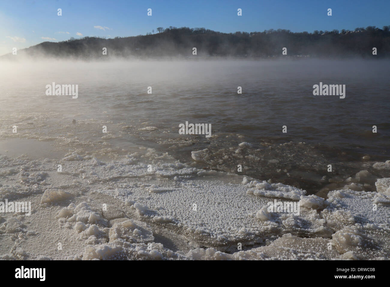 Three states of water - frozen, ice, solid, fog vapor, liquid Ohio river Cincinnati - Stock Image