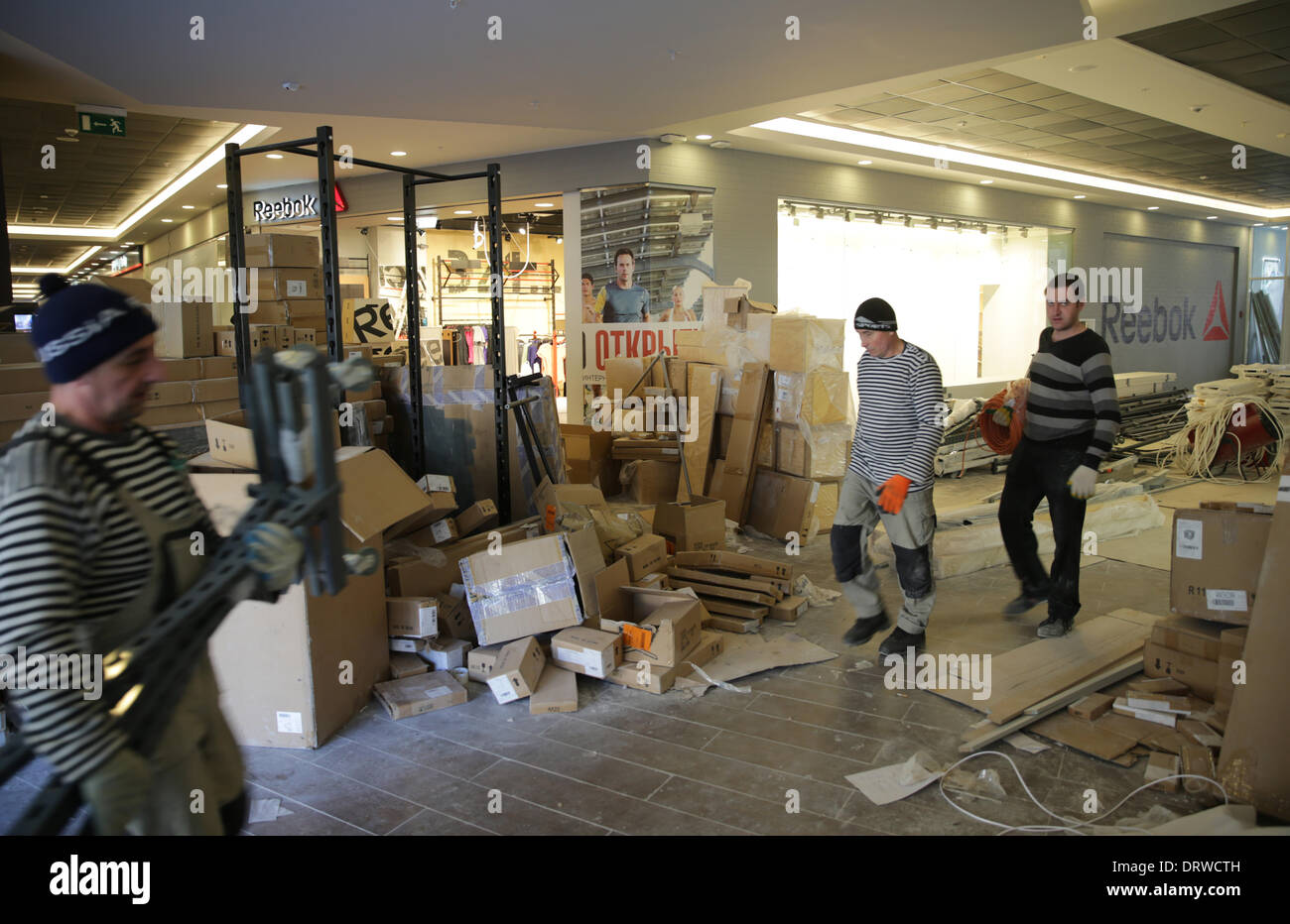 Sochi, Krasnodar region, Russia. 02nd Feb, 2014. Workers walk through the unfinished Gorky Gorod Shopping Mall in Krasnaya Polyana near Sochi, Krasnodar region, Russia, 02 February 2014. The Olympic Winter Games 2014 in Sochi run from 07 to 23 February 2014. Photo: Michael Kappeler/dpa (zu dpa-Meldung: «Hotel-Baustellen bereiten IOC und Organisationskomitee Sorgen» vom 28.01.2014)/dpa/Alamy Live News - Stock Image