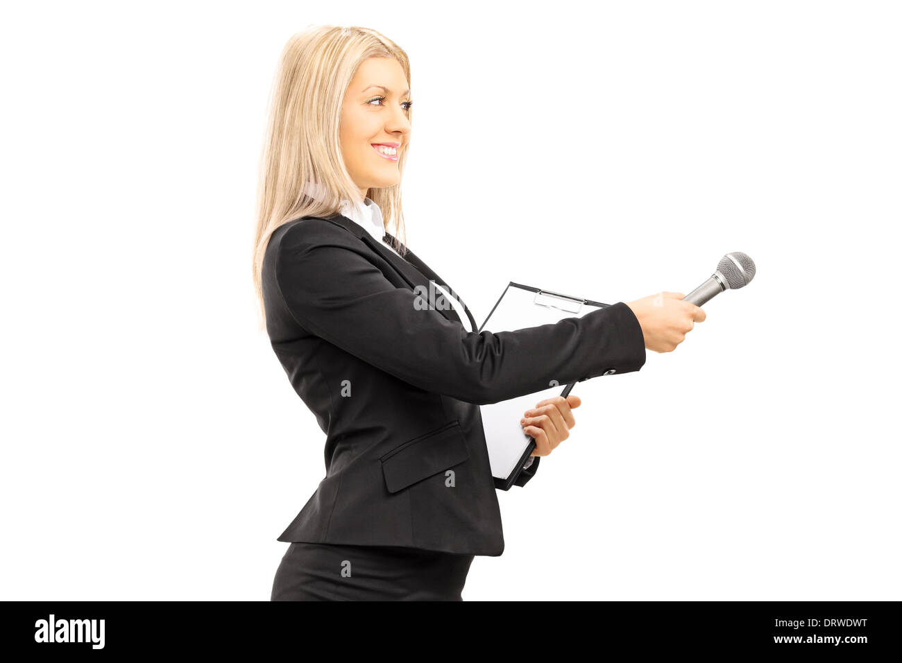 Young female interviewer holding a microphone - Stock Image