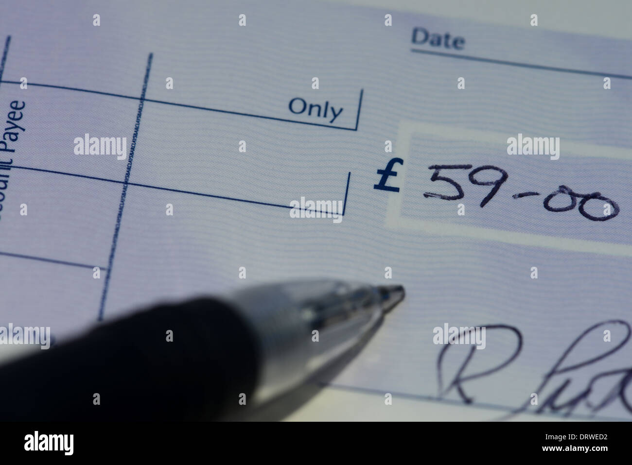 Cheque being written - Stock Image