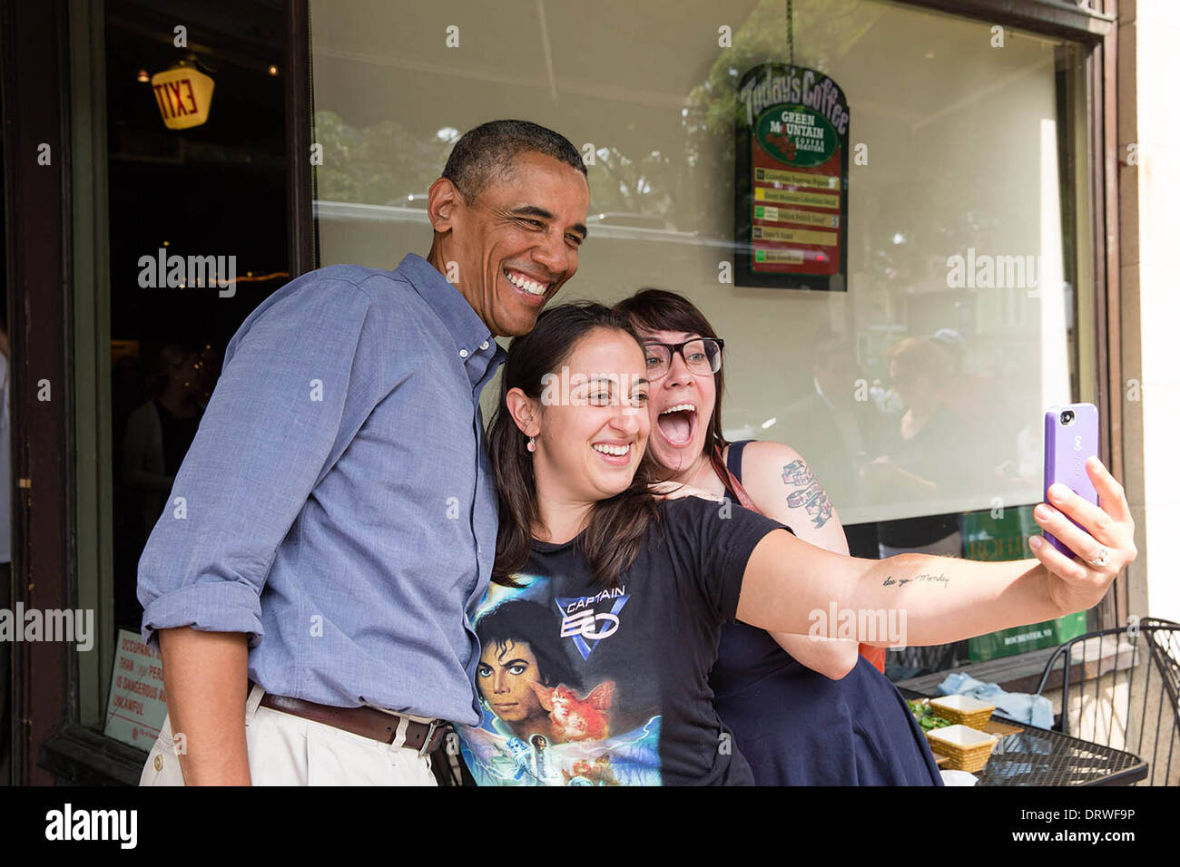US President Barack Obama poses for a picture at Magnolia's Deli & Café during the college affordability bus tour August 22, 2013 in Rochester, New York. - Stock Image