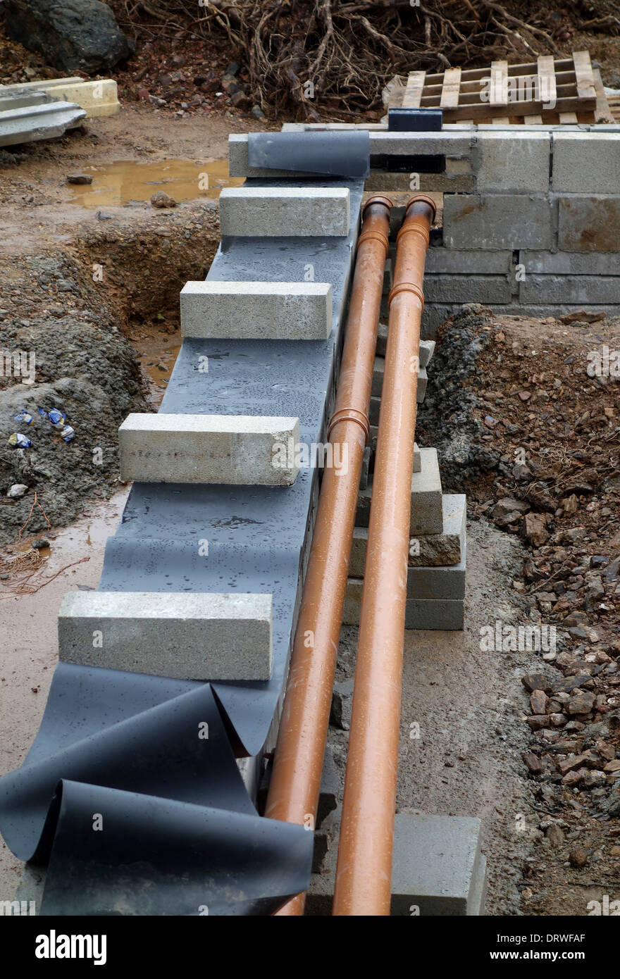 footings and drainage pipes in a new building - Stock Image