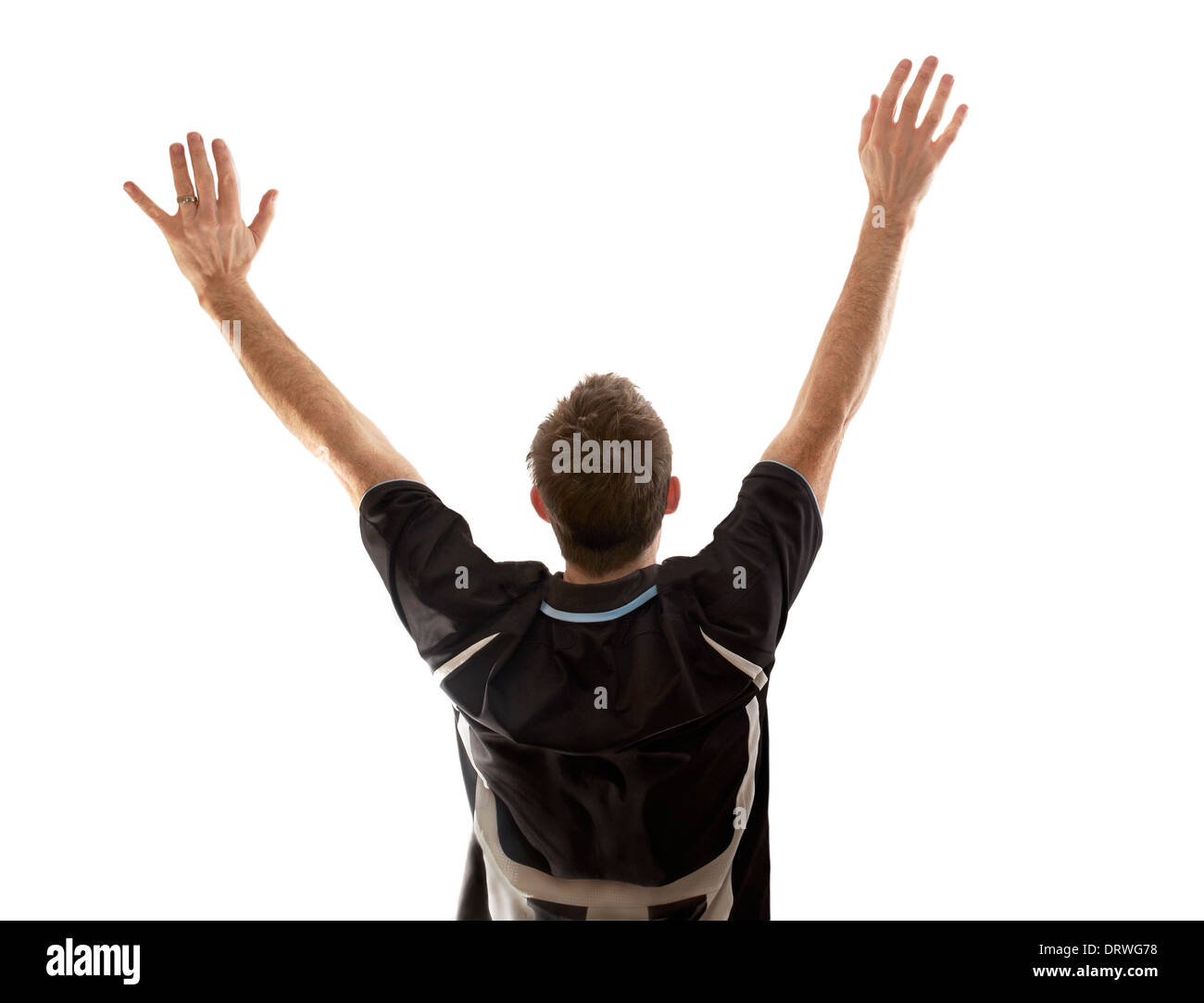 A man celebrating a goal at a football match on a white background. - Stock Image