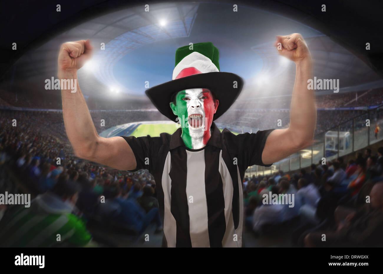An Italian football fan celebrating a goal in a football stadium. Stock Photo