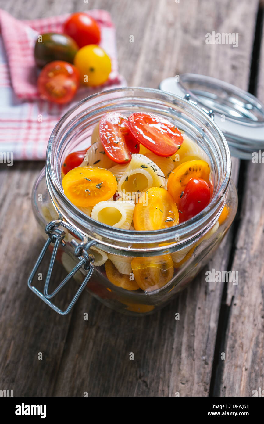 Pasta and cherry tomatoes ready for picnic - Stock Image
