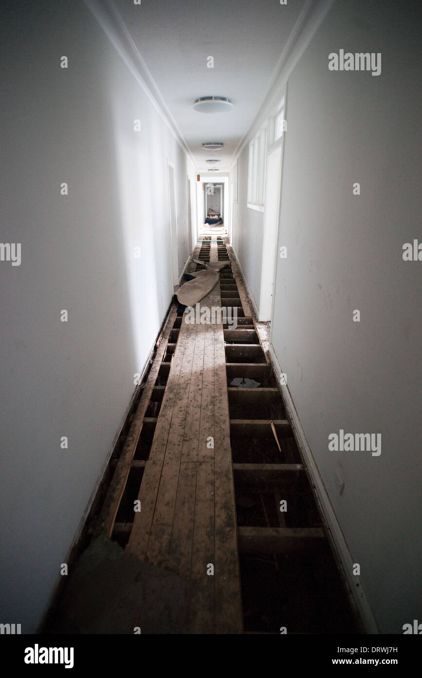 A white corridor with floorboards removed Stock Photo