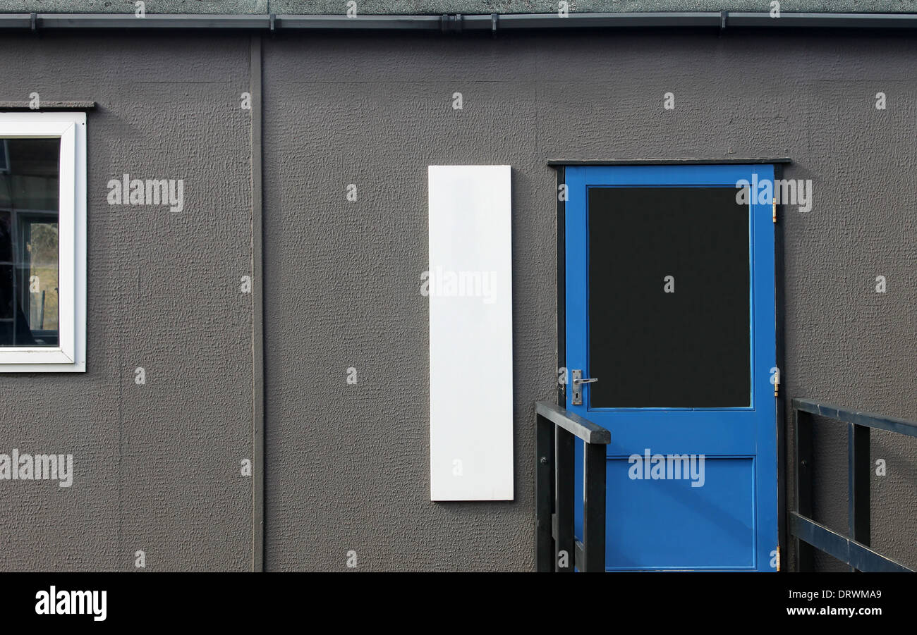 Mobile prefabricated classroom in secondary school. - Stock Image