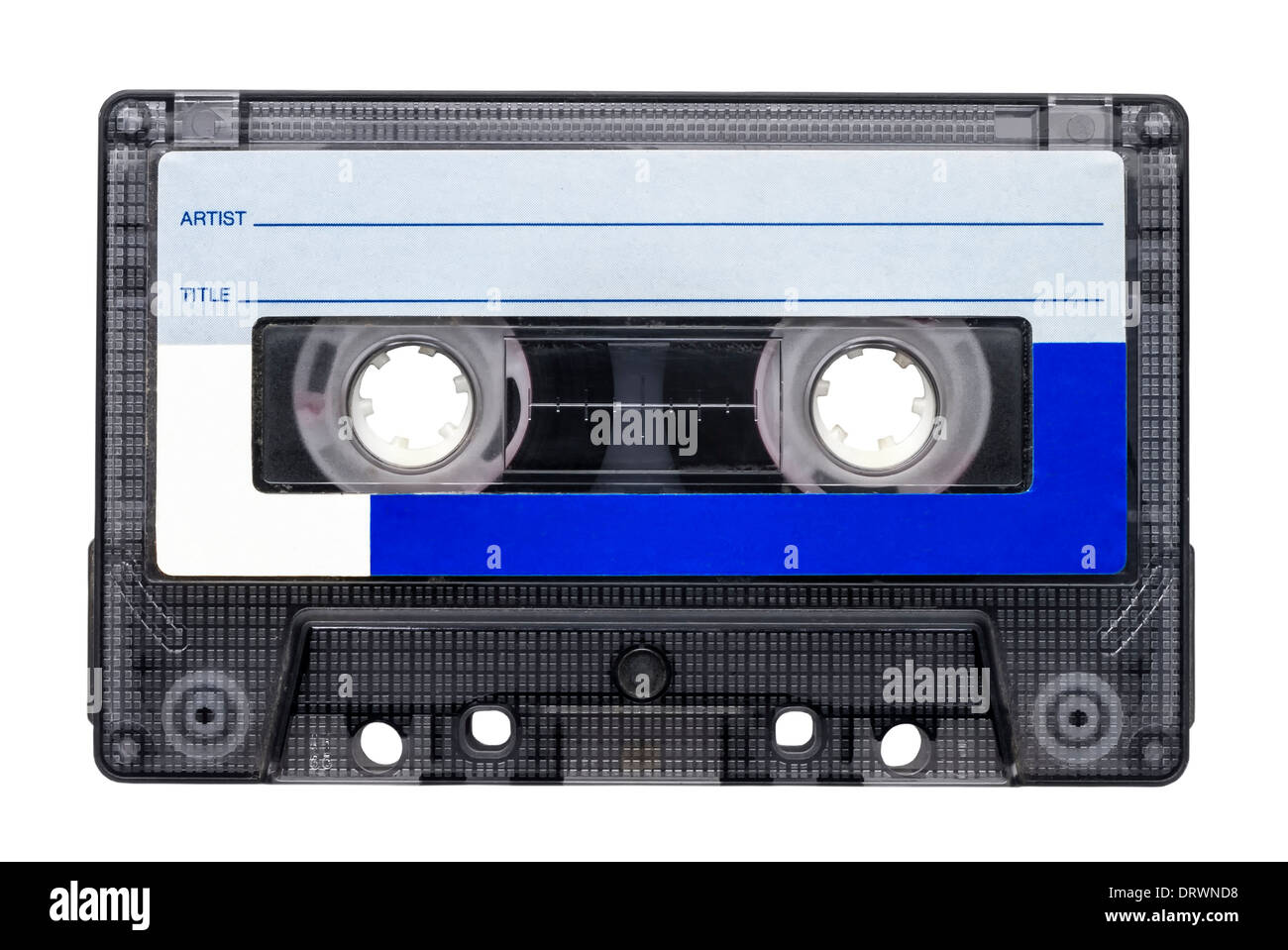 Magnetic tape cassette for audio music recording isolated over white background. - Stock Image