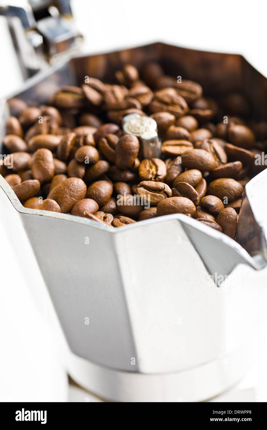 closeup of coffee beans in coffee maker - Stock Image